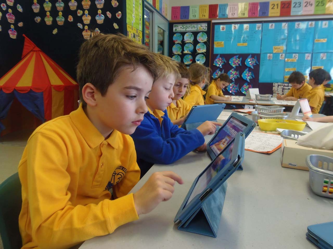 Kindergarten students using iPad.